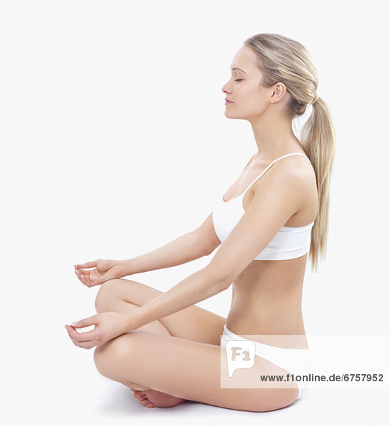 Woman in underwear meditating