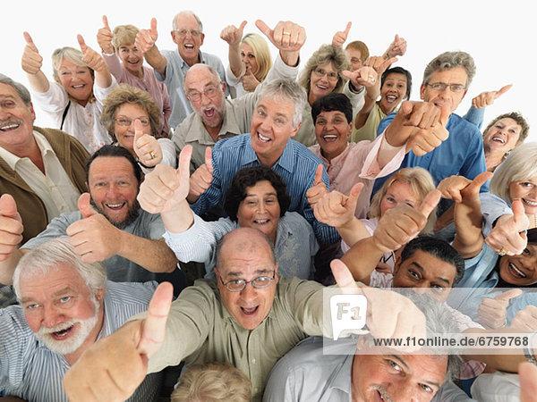 hoch  oben  Mensch  geben  Menschen  Menschengruppe  Menschengruppen  Gruppe  Gruppen  Zeichen  Menschlicher Daumen  Menschliche Daumen  Signal