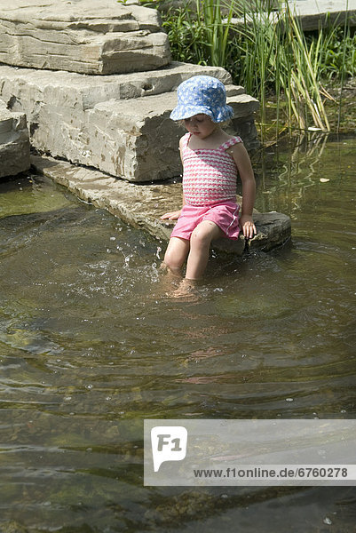 Little Girl Playing in a Pond  Scott's Plains Park  along the Otonabee River  Peterborough  Ontario