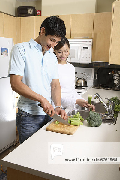 Couple Cooking together in a Condo  Vancouver  British Columbia