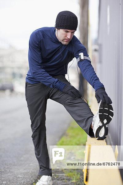 USA  Washington  Seattle  man in sports clothing stretching