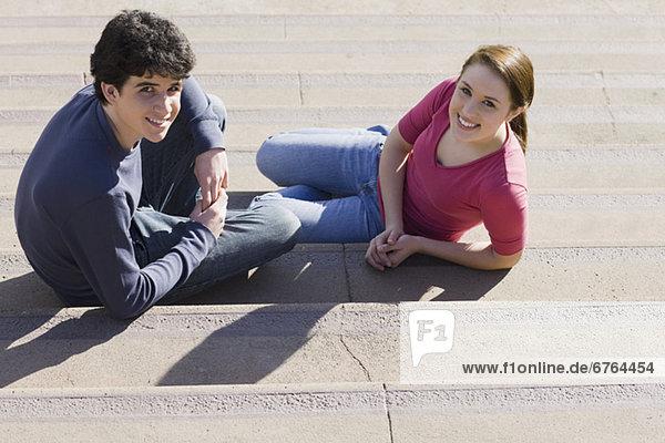 Friends sitting on steps