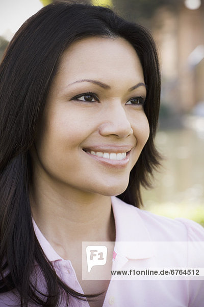 Close-up of woman smiling  outdoors