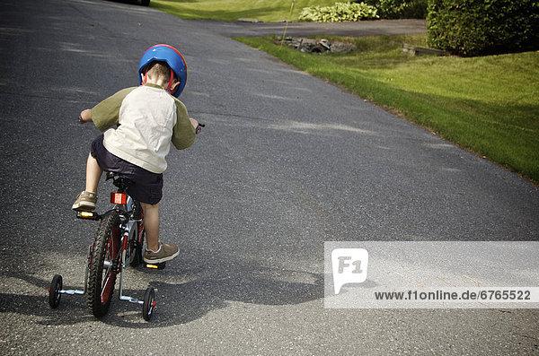 anprobieren  Stützrad  Junge - Person  Training  jung  Quebec