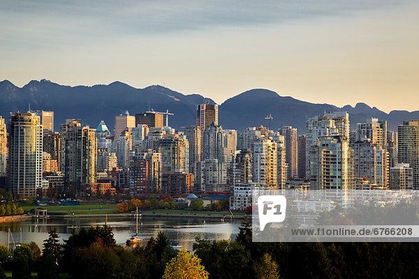 Skyline with Yaletown  False Creek and North Shore Mountains  site of 2010 Winter Olympics  Vancouver  British Columbia