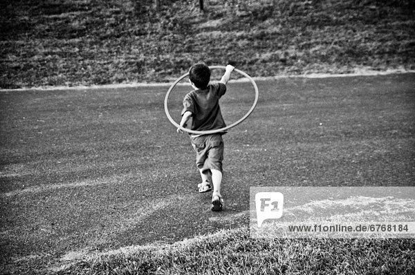 Junge - Person  rennen  jung  einlochen  Quebec