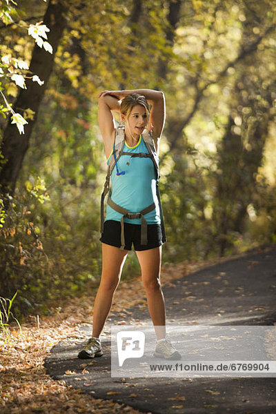 USA  Utah  young woman standing on footpath in forest