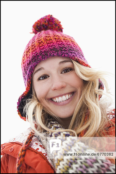 Portrait of young woman wearing winter clothes outdoors