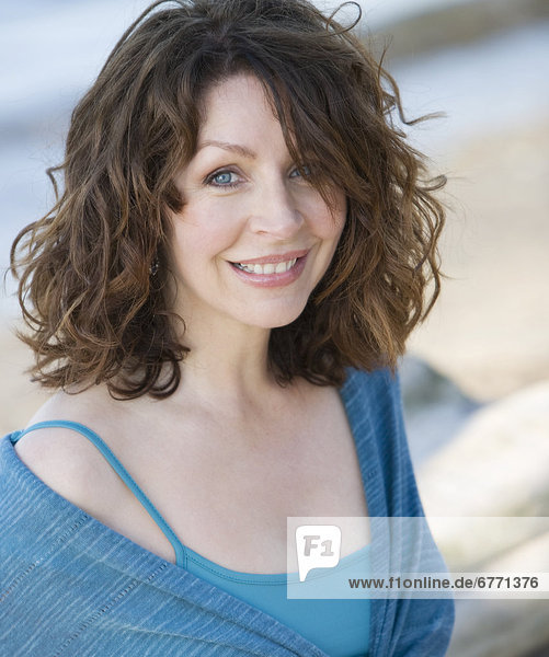 Portrait of a mature woman on a beach  Toronto  Ontario