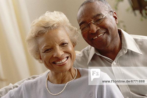 Portrait of a smiling elderly couple