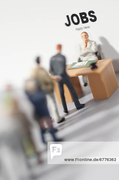Figurines applying for jobs
