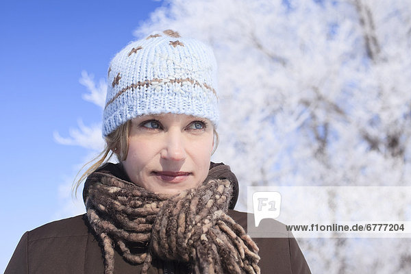 Portrait of a woman outdoors on a frosty winter day  Winnipeg  Manitoba  Canada