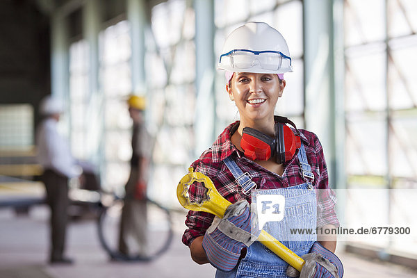 Portrait of female manual worker wearing hardhat
