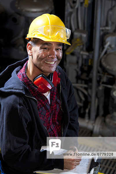 Portrait of male manual worker wearing hardhat