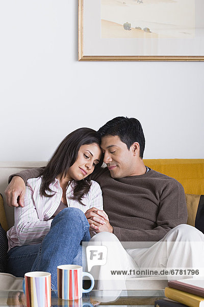 Portrait of couple on sofa