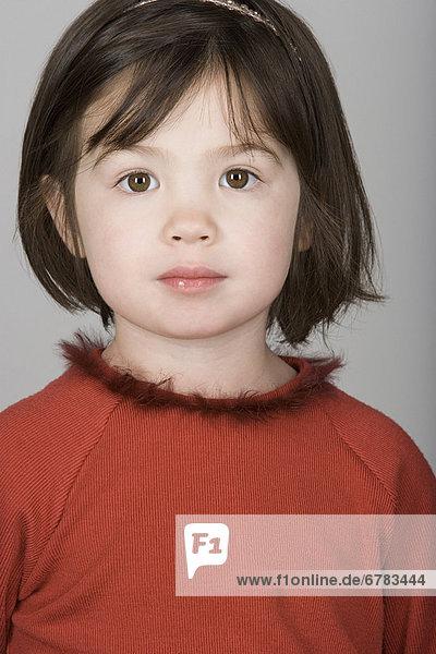 Studio portrait of mixed-race girl (10-11)