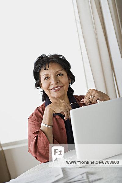 Senior women using laptop at home