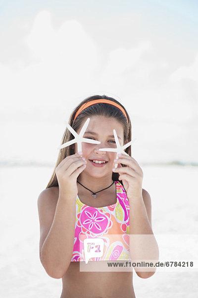 Strand  halten  Mädchen  zart  Seestern