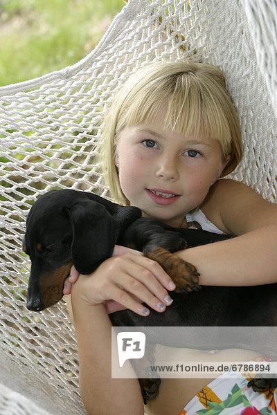 Hängematte  Hund  Mädchen
