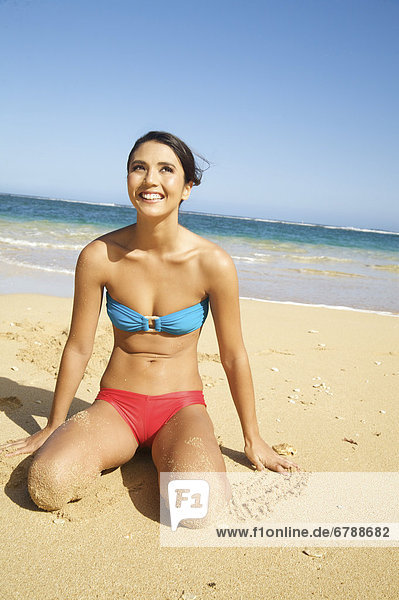 Hawaii  Kauai  Tunnel's beach  Attractive young woman on the beach.