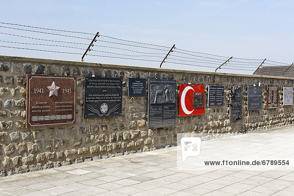 A wall with numerous memorial plaques  Mauthausen concentration camp  Perg  Upper Austria  Austria  Europe
