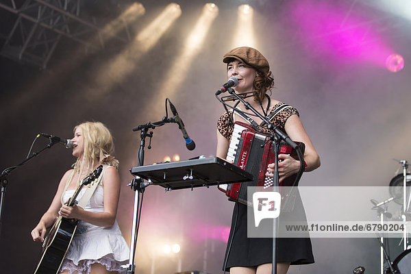 Solveig Heilo with a guitar and Anne Marit Bergheim with an accordion from the Norwegian girl band Katzenjammer performing live at Heitere Open Air in Zofingen  Aargau  Switzerland  Europe