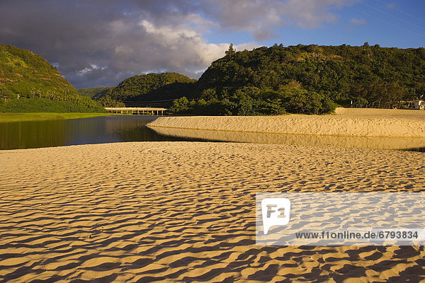 Hawaii  Oahu  North Shore  Waimea Bay  view from beach of valley  river and bridge.