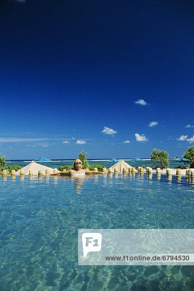 Indonesia  Lombok  Kuta  Novatel Coralia Hotel  tourist in swimming pool.