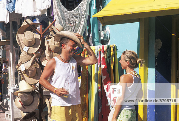 Mexico,  Isla Mujeres,  Couple shopping,  local storefronts.
