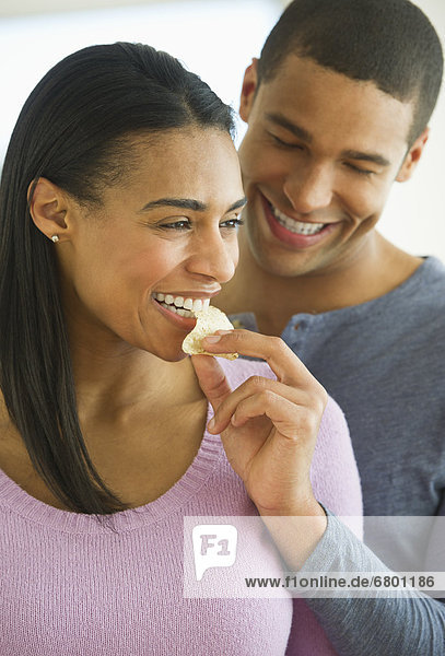 Couple eating potato chips