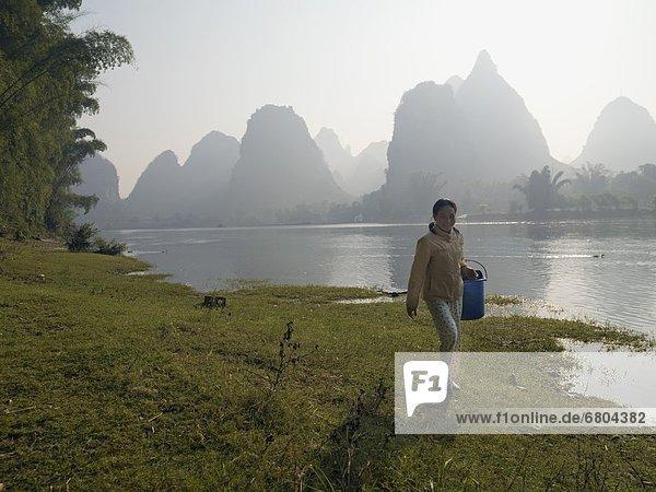 Man Walking By Li River  Yangshuo County  Guangxi Province  China