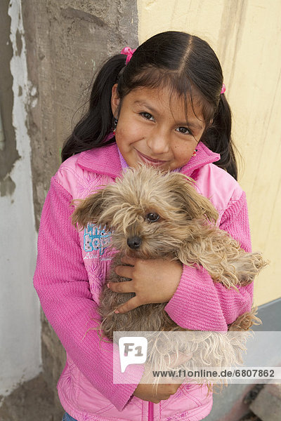 A girl with her pet dog  lima peru