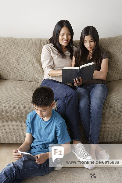 Mother and offspring reading together
