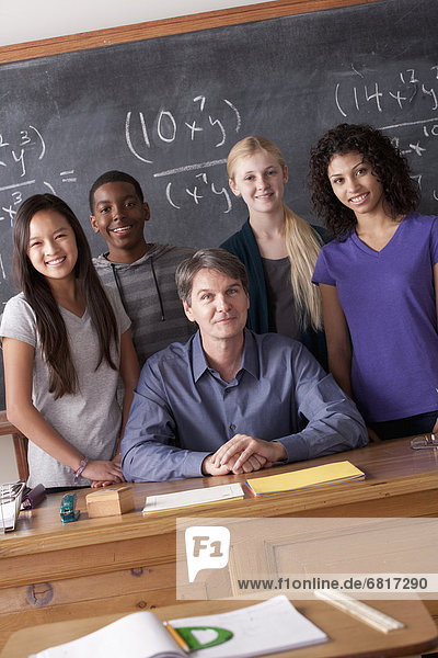 Teacher with teenage students (14-15 16-17) at school