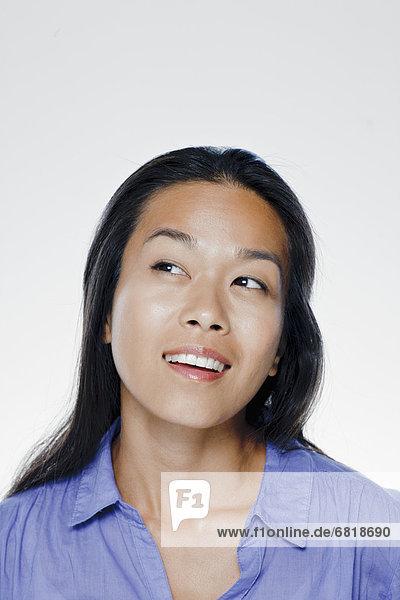 Portrait of smiling young woman  studio shot