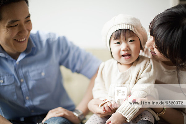 Menschliche Eltern  jung  Mädchen  Baby