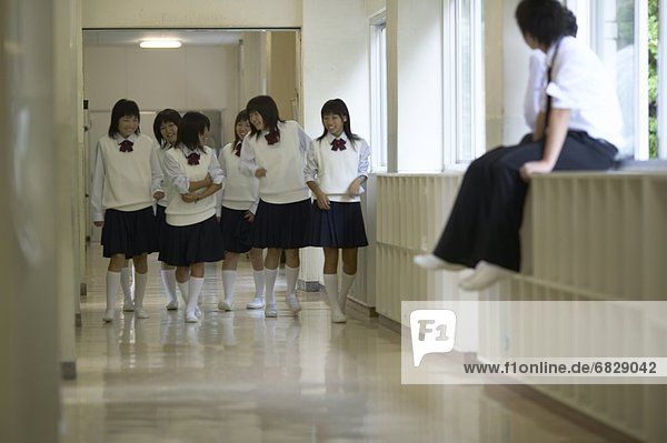School friends laughing in the corridor