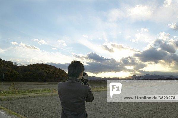 Sonnenuntergang  fangen  Fotograf