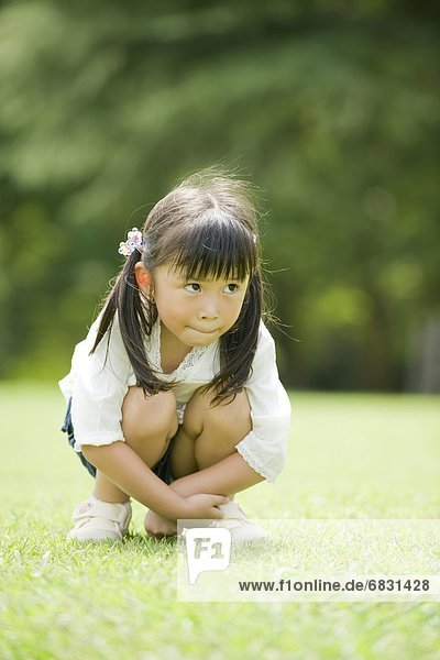 A girl sitting in the park