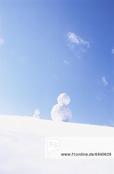 Snowmen Under a Blue Sky