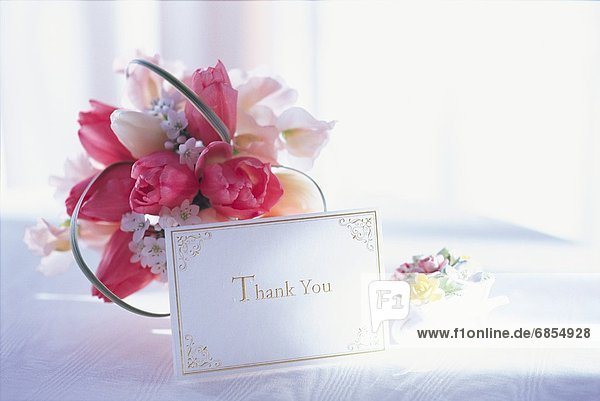 Flowers and a Thank You Card on a Table