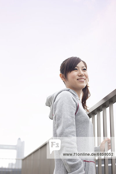 Young woman smiling on rooftop  Japan