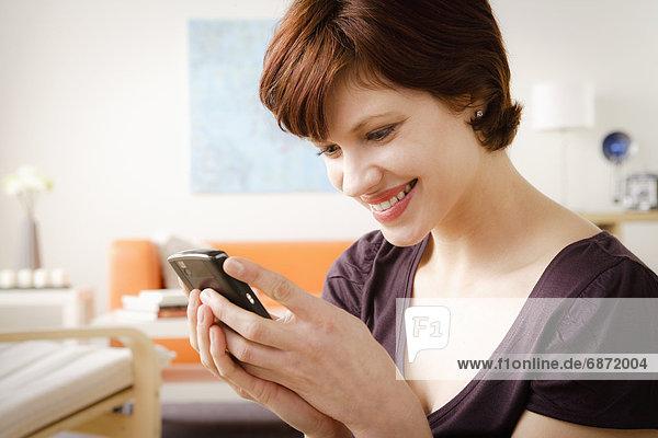 Interior  zu Hause  benutzen  Frau  lächeln