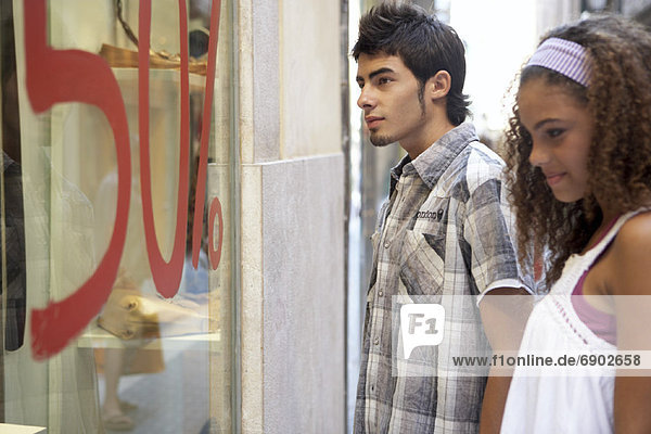 Young Man and Woman Window Shopping