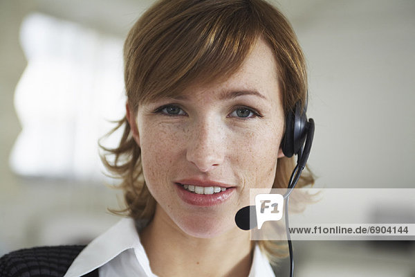 Portrait of Woman with Headset