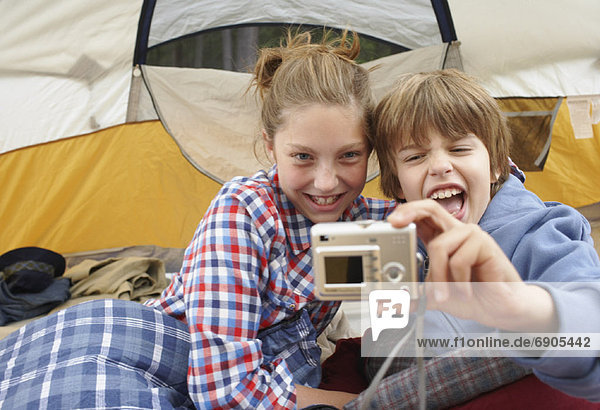 Brother and Sister Taking Picture in Tent