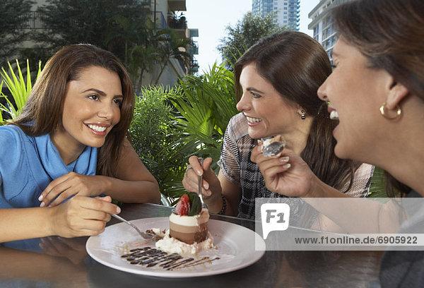 Women Sharing Dessert