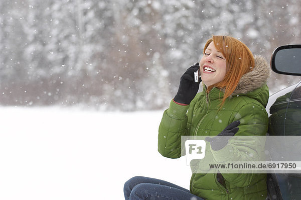 Woman Using Cellular Telephone Outdoors