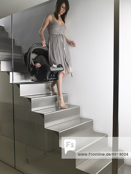 Mother Carrying Baby Down Stairs