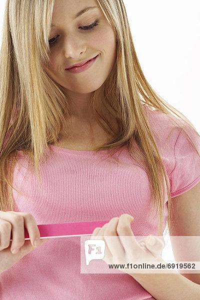 Girl Filing Nails